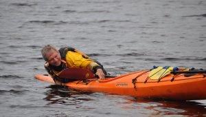 dave climbs back into kayak
