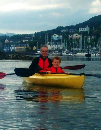man and boy in yellow kayak