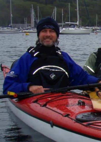 dave in hat in red kayak